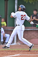 Elizabethton Twins right fielder Kamran Young (39) swings at a pitch during a game against the Johnson City Cardinals on July 30, 2015 in Elizabethton, Tennessee. The Twins defeated the Cardinals 13-4. (Tony Farlow/Four Seam Images)