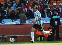 Foward Gonzalo Higuain of Argentina dribbles into the attack. For the match, Higuain would score three goals as his team defeated South Korea, 4-1, in both teams' second match of play in Group B of the 2010 FIFA World Cup. The match was played at Soccer City in Johannesburg, South Africa June 17th.