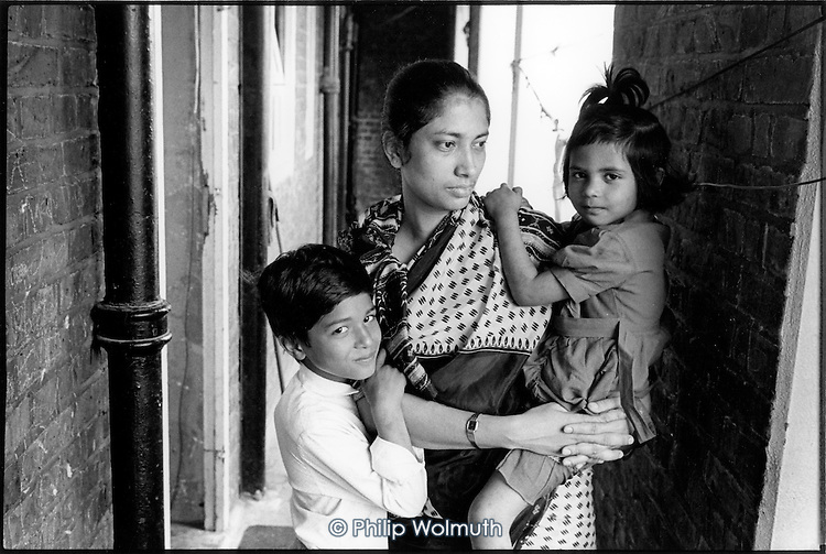 Part of a Bangladeshi family of two adults and five children living in an unfit two-bedroom council flat in Levita House, King's Cross, London 1990.