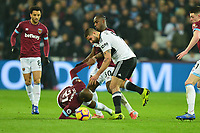 Angelo Ogbonna is fouled by Aleksandar Mitrovic of Fulham during West Ham United vs Fulham, Premier League Football at The London Stadium on 22nd February 2019
