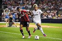 Kevin-Prince Boateng (10) of A. C. Milan and Fabio Coentrao (15) of Real Madrid. Real Madrid defeated A. C. Milan 5-1 during a 2012 Herbalife World Football Challenge match at Yankee Stadium in New York, NY, on August 8, 2012.