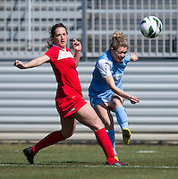 Danielle Hubka (16) of the Washington Spirit tries to stop the cross of Kealia Ohai (7) of the North Carolina Tar Heels  during the game at the Maryland SportsPlex in Boyds, MD.  The Washington Spirit defeated the North Carolina Tar Heels in a preseason exhibition, 2-0.