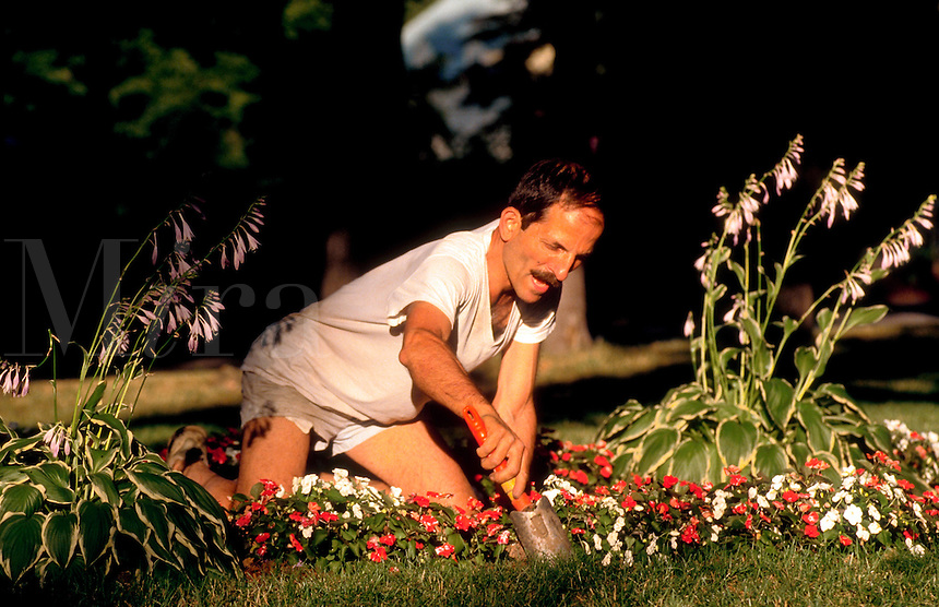 Man working in his flower garden.