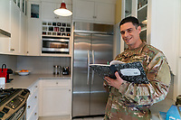 Off duty US soldier in uniform at home studing for his degree, for sale as stock photography