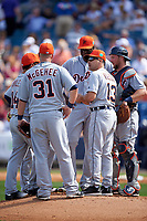 Detroit Tigers coach Omar Vizquel (13) talks with John Mayberry Jr. (64), Ian Kinsler (hidden), Mike Aviles (14), Casey McGehee (31), and Bryan Holaday (50) during a pitching change during a Spring Training game against the New York Yankees on March 2, 2016 at George M. Steinbrenner Field in Tampa, Florida.  New York defeated Detroit 10-9.  (Mike Janes/Four Seam Images)