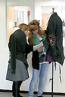 Mother & daughter looking at display mannequins, Open Day at Kingston College when prospective students and their parents look around.