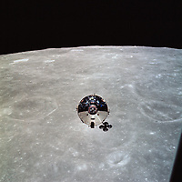 The Command and Service Modules (CSM) as seen in lunar orbit from the Lunar Module (LM) after CSM/LM separation,  22 May 1969,