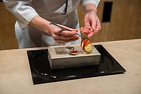 Japan, Kyoto. Hoshinoya, a resort. The pastry chef making dessert. Model released