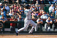 Salt River Rafters center fielder Monte Harrison (4), of the Miami Marlins organization, hits a line drive up the middle for an RBI-single during the Arizona Fall League Championship Game against the Peoria Javelinas at Scottsdale Stadium on November 17, 2018 in Scottsdale, Arizona. (Zachary Lucy/Four Seam Images)