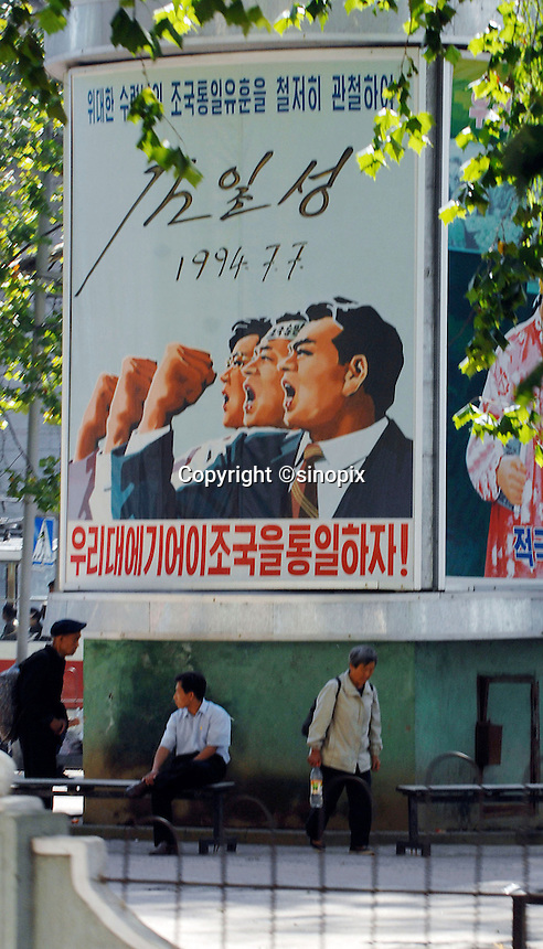 "Propaganda poster in Pyongyang, North Korea. The DPRK (Democratic People's Republic of Korea) is the last great dictatorship where the people are bombarded with images of the ""Eternal President"" Kim Il-sung who died in 1994  and his son and current leader Kim Jong-il who are worshipped like a God."