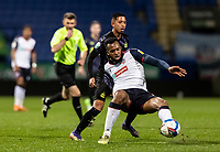 Bolton Wanderers' Reiss Greenidge (right) competing with Newcastle United U21's Rodrigo Vilca<br /> <br /> Photographer Andrew Kearns/CameraSport<br /> <br /> EFL Papa John's Trophy - Northern Section - Group C - Bolton Wanderers v Newcastle United U21 - Tuesday 17th November 2020 - University of Bolton Stadium - Bolton<br />  <br /> World Copyright © 2020 CameraSport. All rights reserved. 43 Linden Ave. Countesthorpe. Leicester. England. LE8 5PG - Tel: +44 (0) 116 277 4147 - admin@camerasport.com - www.camerasport.com