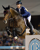 WELLINGTON, FL - APRIL 02: Grand prix action at the 2016 Winter Equestrian Festival (WEF) concluded with an exciting international showdown Saturday night as Great Britain's Ben Maher and Jane Clark's Sarena jumped to victory in the $500,000 Rolex Grand Prix CSI 5*. The finale grand prix for the winter circuit, Maher and Sarena topped a seven-horse jump-off, with McLain Ward (USA) and HH Azur in second, and Meredith Michaels-Beerbaum (GER) and Fibonacci 17 third. The Winter Equestrian Festival (WEF) is the largest, longest running hunter/jumper equestrian event in the world held at the Palm Beach International Equestrian Center on April 2, 2016  in Wellington, Florida.<br /> <br /> <br /> People:  Liubov Kochetova