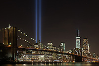 The Tribute in Light memorial on the 13th anniversary of 9/11. View from Brooklyn Bridge Park.  Sept. 11, 2014. New York, USA.