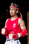 Sundui Batjargal (Red) of Mongolia enters to the ring prior the male muay 67KG division weight bout against against Ng Yuen Sing (Not in picture) of Hong Kong during the East Asian Muaythai Championships 2017 at the Queen Elizabeth Stadium on 11 August 2017, in Hong Kong, China. Photo by Yu Chun Christopher Wong / Power Sport Images