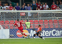 27 July 2010: Toronto FC forward Chad Barrett #19 scores the games only goal during a CONCACAF Preliminary game between Club Deportivo Motagua and Toronto FC at BMO Field in Toronto..Toronto FC won 1-0....27 July 2010: Toronto FC forward Chad Barrett #19 scores the games only goal on Club Deportivio Motagua goalkeeper Donaldo Antonio Morales #22 during a CONCACAF Preliminary game between Club Deportivo Motagua and Toronto FC at BMO Field in Toronto..Toronto FC won 1-0....