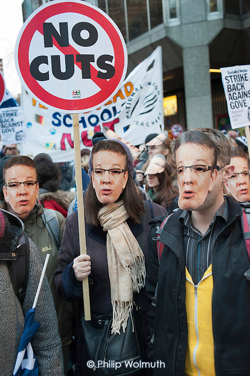 Teachers wearing Michael Gove masks rally in Westminster to protest at government policies on pensions, pay & conditions, academies and education cuts.