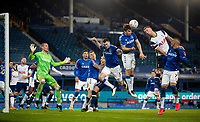 10th February 2021, Goodison Park, Liverpool, England;  Evertons Seamus Coleman 3rd R heads the ball away from danger during the FA Cup 5th round match between Everton FC and Tottenham Hotspur FC at Goodison Park