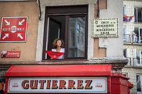PAMPLONA, SPAIN - July 06: A woman holds a scarf in a window in the Old Town where the ''txupinazo'' would usually take place to start the famous San Fermin festival, which was canceled this year by the conoravirus. In Pamplona, July 06, 2020 (Photo by Maite H. Mateo /VIEWpress via Getty Images)