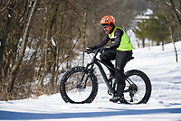Glenn Eyler of Kansas City, Mo. rides through snow, Friday, February 19, 2021 along Slaughter Pen Trail in Bentonville. Check out nwaonline.com/210220Daily/ for today's photo gallery. <br /> (NWA Democrat-Gazette/Charlie Kaijo)