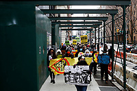 NEW YORK, NEW YORK - MARCH 06: People walk in sidewalk during a demonstration in support of woman workers on March 06, 2021 in New York. (Photo by John Smith/VIEWpress)