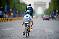 Most endearing moment on the Champs-Elysées parade of the teams (after the winners ceremony): Niki Terpstra (NLD/OmegaPharma-Quickstep) followed by his 5yr old son Luca. In the white jersey...<br /> <br /> 2014 Tour de France<br /> stage 21: Evry - Paris Champs-Elysées (137km)