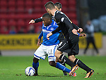 St Johnstone v Motherwell......27.10.13      SPFL<br /> Nigel Hasselbaink is closed down by Keith Lasley and Simon Ramsden<br /> Picture by Graeme Hart.<br /> Copyright Perthshire Picture Agency<br /> Tel: 01738 623350  Mobile: 07990 594431