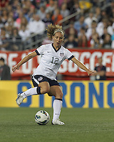 USWNT midfielder Lauren Cheney (12) dribbles. In an international friendly, the U.S. Women's National Team (USWNT) (white/blue) defeated Korea Republic (South Korea) (red/blue), 4-1, at Gillette Stadium on June 15, 2013.