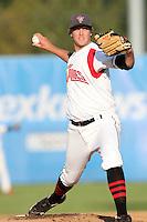 Salem-Keizer pitcher Cameron Lamb #28 pitches against the Eugene Emeralds at Volcanoes Stadium on August 9, 2011 in Salem-Keizer,Oregon. Eugene defeated Salem-Keizer 13-7.(Larry Goren/Four Seam Images)