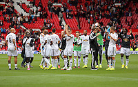 Pictured: Swansea players thank supporters after the final whistle. Saturday 16 August 2014<br /> Re: Premier League Manchester United v Swansea City FC at the Old Trafford, Manchester, UK.