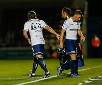 The moment Gareth Ainsworth (Manager) of Wycombe Wanderers came on as a substitute for Dayle Southwell of Wycombe Wanderers  (right) during the The Checkatrade Trophy match between Northampton Town and Wycombe Wanderers at Sixfields Stadium, Northampton, England on 30 August 2016. Photo by David Horn / PRiME Media Images.