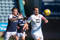 24th April 2021; Dens Park, Dundee, Scotland; Scottish Championship Football, Dundee FC versus Raith Rovers; Kyle Benedictus of Raith Rovers has his eye on the ball as Jason Cummings of Dundee closes him down