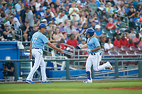Omaha Storm Chasers Kyle Isbel (3) is congratulated by manager Brian Poldberg (27) after hitting a home run during a game against the Iowa Cubs on August 14, 2021 at Werner Park in Omaha, Nebraska. (Zachary Lucy/Four Seam Images)