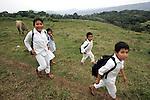 Naua Indian children make their way back home in the village of Ayotzinapan, Puebla. Photo by Heriberto Rodriguez/ CGEIB