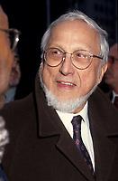 FILE -  Denis Lazure lors d'une funeraille dans les annes 90