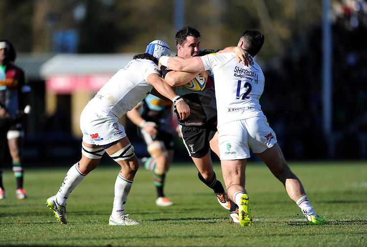 Dave Ward of Harlequins is tackled by Blair Cowan and Eamonn Sheridan of London Irish during the Aviva Premiership Rugby match between Harlequins and London Irish at The Twickenham Stoop on Saturday 7th March 2015 (Photo by Rob Munro)