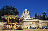 Paris. Sacre Coeur, merry go round and student gathering. France..