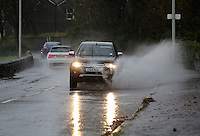 WEATHER WALES<br /> Pictured: A car drives through a flooded road by Mumbles promenade in Swansea, Wales, UK. Monday 21 November 2016<br /> Re: Flood warnings have been issued and Severe rain will be affecting most parts of Wales, UK