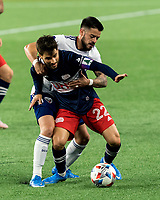 FOXBOROUGH, MA - APRIL 24: Carles Gil #22 of New England Revolution dribbles as Junior Moreno #5 of D.C. United defends during a game between D.C. United and New England Revolution at Gillette Stadium on April 24, 2021 in Foxborough, Massachusetts.