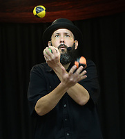 George Reader, a magician from Bella Vista, juggles Wednesday, July 21, 2021, during a performance at the Prairie Grove Public Library. The show was the finale for the library's summer reading program. Visit nwaonline.com/210722Daily/ for today's photo gallery.<br /> (NWA Democrat-Gazette/Andy Shupe)