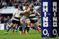 Jon Fisher of England is tackled by George Smith and Thomas Waldrom of Barbarians during the match between England and Barbarians at Twickenham Stadium on Sunday 31st May 2015 (Photo by Rob Munro)