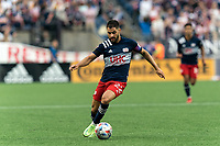 FOXBOROUGH, MA - JULY 25: Carles Gil #22 of New England Revolution brings the ball forward during a game between CF Montreal and New England Revolution at Gillette Stadium on July 25, 2021 in Foxborough, Massachusetts.