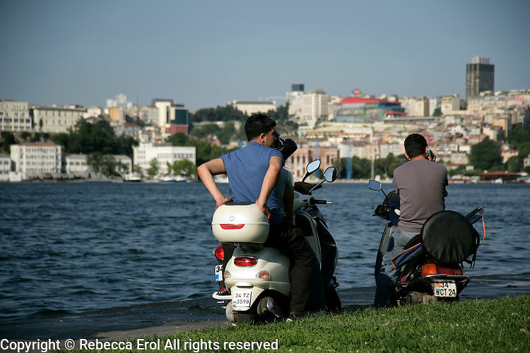 Turkish boys on motorbikes by the Golden Horn, Istanbul, Turkey