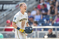 Michigan Wolverines first baseman Jimmy Kerr (15) celebrates after hitting a home run during Game 11 of the NCAA College World Series against the Texas Tech Red Raiders on June 21, 2019 at TD Ameritrade Park in Omaha, Nebraska. Michigan defeated Texas Tech 15-3 and is headed to the CWS Finals. (Andrew Woolley/Four Seam Images)