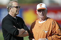 Actor Kevin Costner talks with Texas Longhorns Head Coach Augie Garrido before a game against the Tulane Green Wave at Goodwin Field on February 28, 2003 in Fullerton, California. (Larry Goren/Four Seam Images)