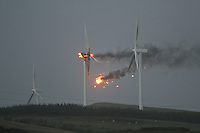 A wind turbine bursts into flames in Biblical style  in Ardrossan as storms tear across Scotland..Picture: Stuart McMahon/Universal News And Sport (Scotland)  8 December 2011.