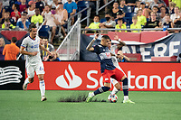 FOXOBOROUGH, MA - AUGUST 21: Gustavo Bou #7 of New England Revolution slides to take possession of the ball as Ronald Matarrita #18 of FC Cincinnati pressures during a game between FC Cincinnati and New England Revolution at Gillette Stadium on August 21, 2021 in Foxoborough, Massachusetts.