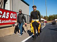 Oct 14, 2019; Concord, NC, USA; NASCAR Cup Series driver Kyle Larson (left) and son Owen Larson talk with NHRA funny car driver J.R. Todd during the Carolina Nationals at zMax Dragway. Mandatory Credit: Mark J. Rebilas-USA TODAY Sports