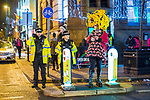"""© Joel Goodman - 07973 332324 . 15/12/2017. Manchester, UK. A club promoter wearing drag hands out flyers on Sackville Street in Manchester's """" Gay Village """" . Revellers out in Manchester City Centre overnight during """" Mad Friday """" , named for historically being one of the busiest nights of the year for the emergency services in the UK . Photo credit : Joel Goodman"""