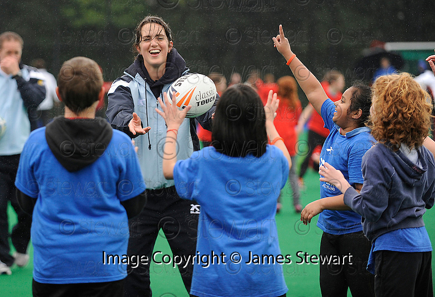 PUPILS FROM FLORA STEVENSON GET SOME COACHING FROM A SCOTTISH PLAYER AT THE TOUCH WORLD CUP YOUTH FESTIVAL AT PEFFERMILL.
