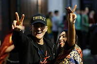 Pictured: Two revellers give victory signs. Sunday 31 December 2017 and 01 January 2018<br /> Re: New Year revellers in Wind Street, Swansea, Wales, UK